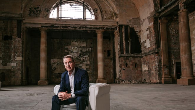 """alt=""""Ford Motor Co. Executive Chairman Bill Ford Jr. poses for a photo in Michigan Central Station in Detroit's Corktown neighborhood in Detroit on Wednesday, June 13, 2018."""""""