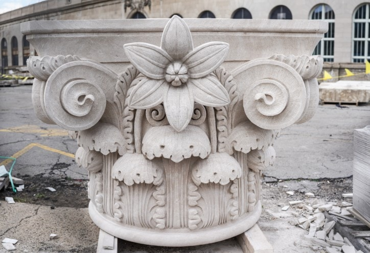 John Goodrow Sr., of Capital Stoneworks Inc., located in Bridgeport, Michigan; spent 428 hours carving the capital stone from a 21,000-pound limestone block