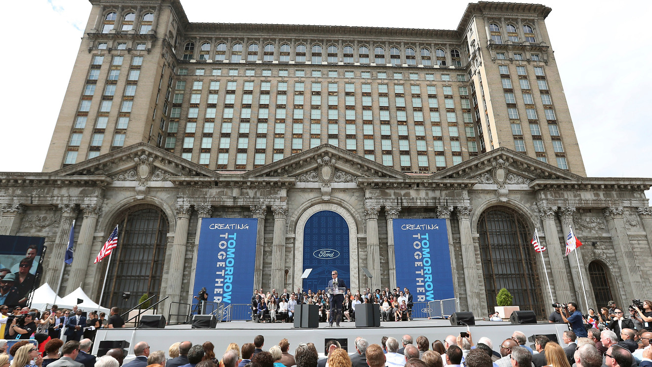 In this June 19, 2018, file photo, Ford Motor Co., Executive Chairman Bill Ford addresses attendees outside the Michigan Central Train Depot, in Detroit. Ford Motor Co. is expanding its footprint in Detroit's Corktown neighborhood by adding onto plans that began with its purchase and renovation of the massive and once-derelict station. The Dearborn, Michigan-based automaker also plans to turn a vacant book warehouse into the industrial center for its 30-acre Michigan Central mobility innovation district. Details were released Tuesday, Nov. 17, 2020, and are part of Ford's $740 million project to create an innovation hub to help shape the way people and goods will move around in the future.
