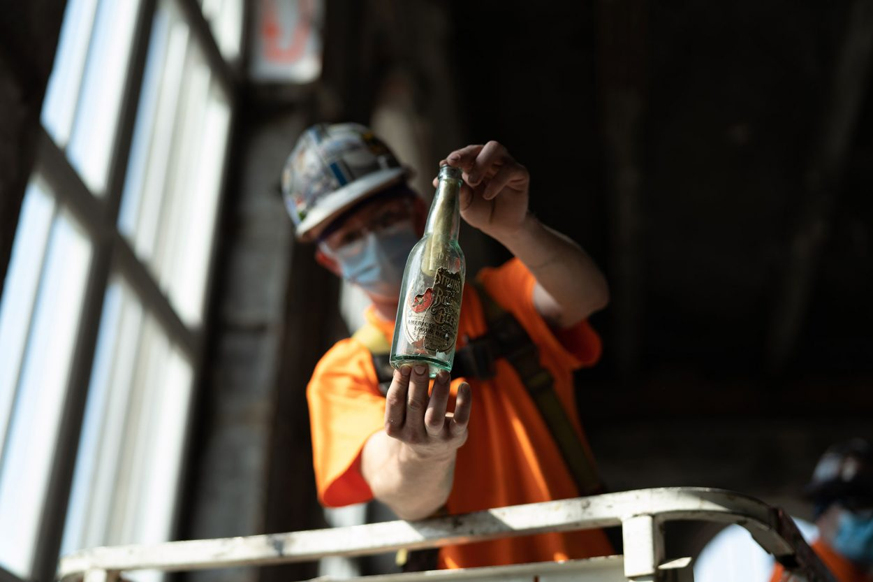 A clean-up worker discovers a bottle of history.