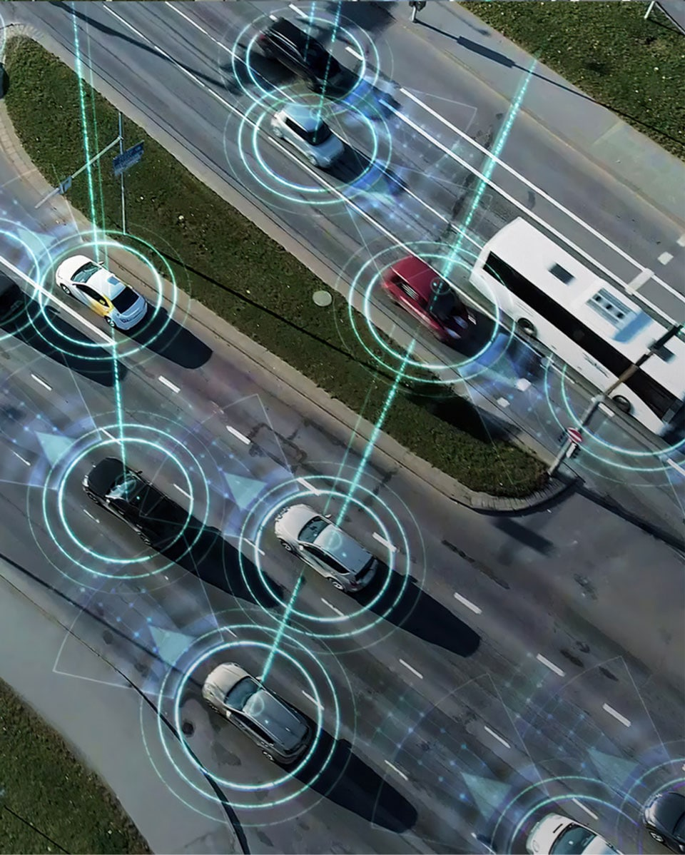 Artist interpretation of self-driving cars on a busy highway.